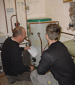 Image of people and boiler