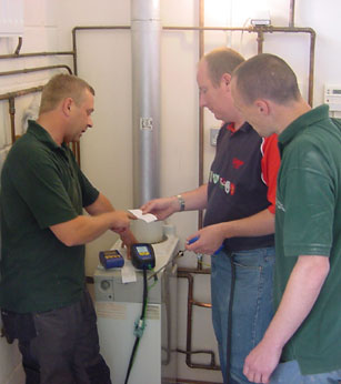 Image of three men testing equipment